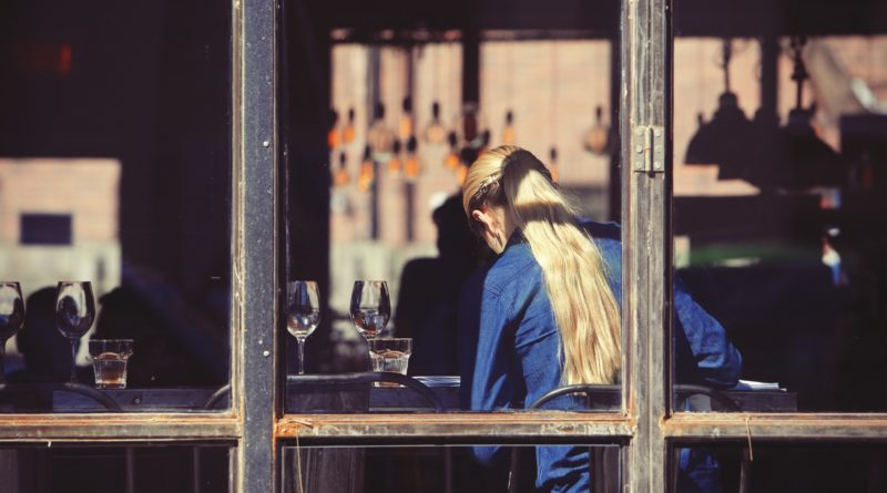 Woman in a restaurant.