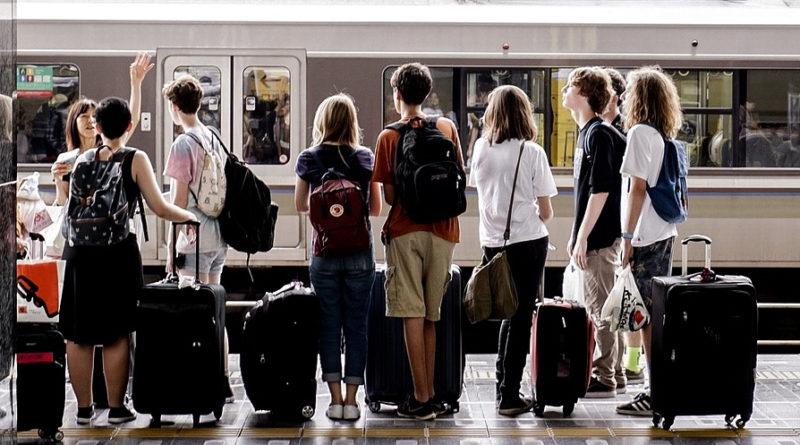 People waiting at station.